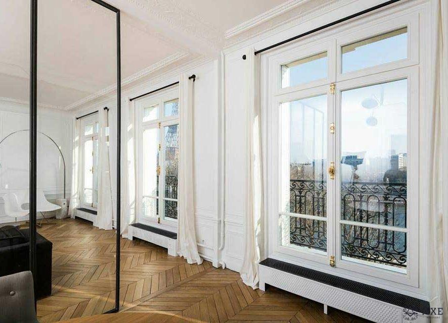 Fenêtres à recouvrement en bois sur-mesure